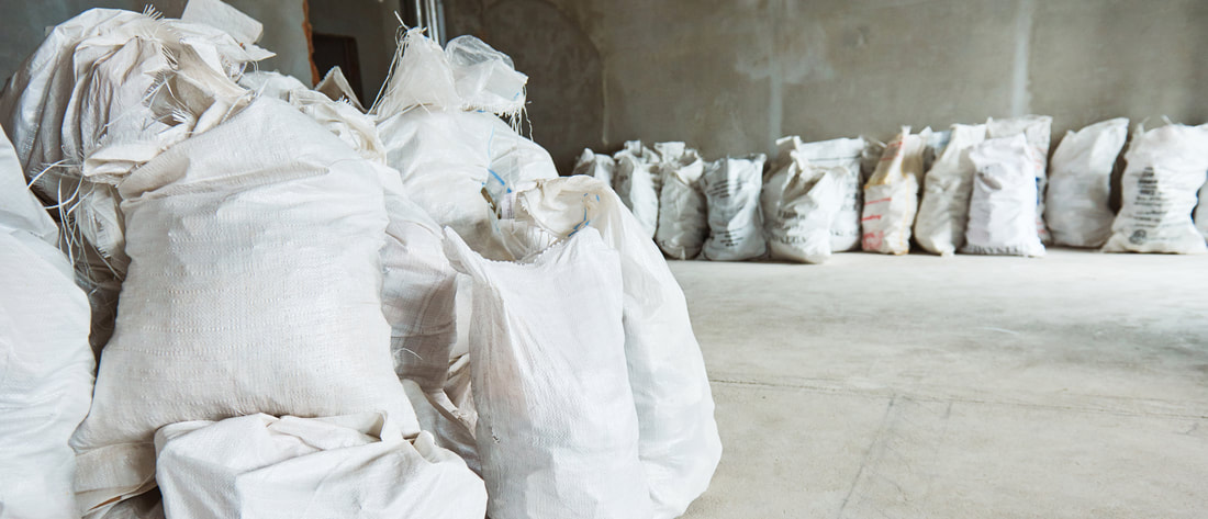 picture of garbage bags piled up in a warehouse after it was cleaned in buffalo ny